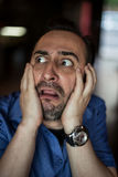 Scared bearded man screaming with frustration Stock Photos