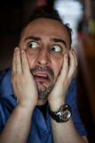 Scared bearded man screaming with frustration Stock Photography