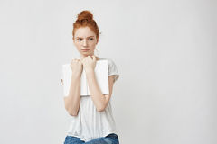 Scared beautiful redhead girl holding book looking in side. royalty free stock photography