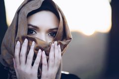 Scared beauty arabic woman in hijab outdoors. Refugee problem royalty free stock image