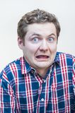 Scared big eyes man with open mouth portrait. Portrait of young stressed shocked emotional big eyes man with open mouth on white background Royalty Free Stock Photos