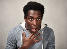 Scared black man face. Scared nervous african american man. People emotions portrait Stock Photo