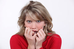 Scared blond woman Stock Image