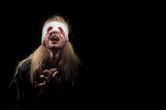 Scared bloody girl Stock Images