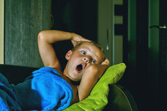 A scared boy in bed at night . Children`s fears Stock Images