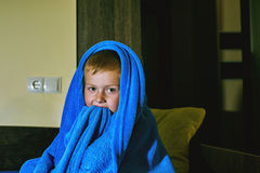 A scared boy in bed at night . Children`s fears stock photography