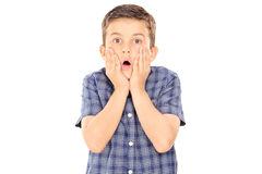 Scared boy gesturing surprise. Isolated on white background Stock Photo