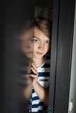 Scared boy hiding in wardrobe Royalty Free Stock Images