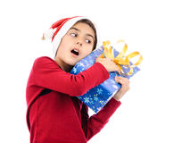 Scared boy keeping tight close gift box Stock Photos