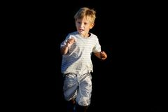 Scared boy running away Royalty Free Stock Images