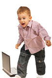 Scared boy runny from laptop Royalty Free Stock Photo