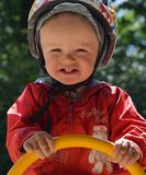 Scared boy on the swing Stock Photography