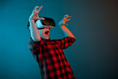 Scared boy in VR headset Stock Images