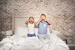 Scared brother and sister in bedroom stock images