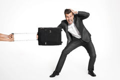 Scared business man hold his luggage Royalty Free Stock Photo