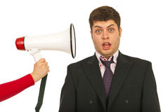 Scared business man by megaphone shout Royalty Free Stock Photos