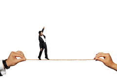 Scared businessman balancing on the rope royalty free stock images