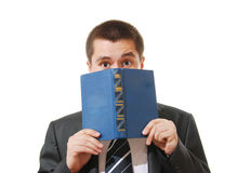 Scared businessman with a book closing his face Royalty Free Stock Images