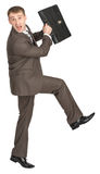 Scared businessman with briefcase Stock Photography