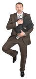 Scared businessman with briefcase Stock Images