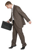 Scared businessman with briefcase Royalty Free Stock Photo