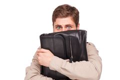 Scared businessman with briefcase Royalty Free Stock Image