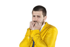 Scared businessman chewing nails Royalty Free Stock Photo