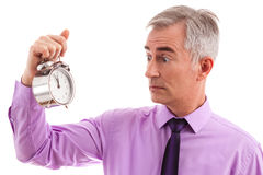 Scared businessman with clock Royalty Free Stock Photography