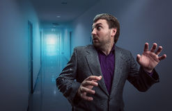 Scared businessman in the corridor Royalty Free Stock Photo