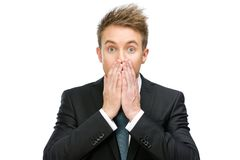 Scared businessman covers open mouth Royalty Free Stock Photo