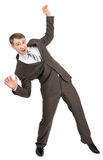 Scared businessman in falling position Royalty Free Stock Image
