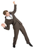 Scared businessman in falling position Royalty Free Stock Photos