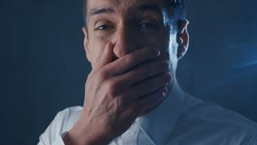 Scared businessman is frightened and afraid covers his face with hand. Scared businessman is frightened and afraid covers his face with his hand stock video footage