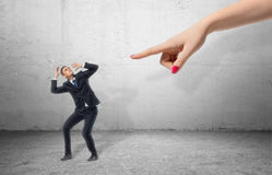 Free Scared Businessman Full-height In Desperate Pose And Giant Hand Pointing At Him Stock Image - 80568201
