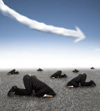 Scared businessman hiding on the ground with business graph down Stock Photography