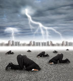 Scared businessman hiding on the ground with storm Stock Images