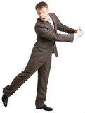 Scared businessman hugging empty space Royalty Free Stock Photos