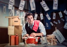 Scared businessman is laundering money Royalty Free Stock Photo