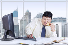 Scared businessman looking at monitor Royalty Free Stock Photos