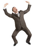 Scared businessman looking up Stock Images