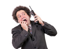 Scared businessman with phone Royalty Free Stock Photo