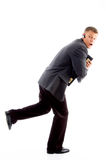 Scared businessman running Stock Photography