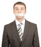 Scared businessman with tape over his mouth Royalty Free Stock Image