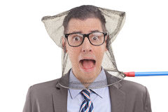 Scared businessperson caught in a fishing net Stock Image