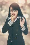 Scared businesswoman with bokeh background Royalty Free Stock Photography