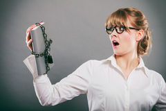 Scared businesswoman with chained document file. Stock Images