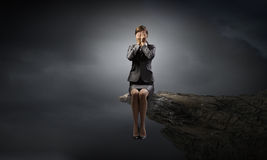 Scared businesswoman. Young businesswoman covering her eyes with hands Stock Images