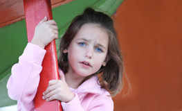 Scared child. A caucasian child scared of heights looking very concerned Royalty Free Stock Photo