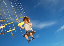 Scared Child on fairground ride. Stock Photo