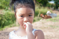 Scared child girl. Portrait Of little girl Biting Nails Royalty Free Stock Photography